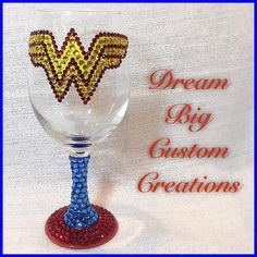 Wonder Woman Bling Hand Painted Wine Glass by DreamBigCC on Etsy https://www.etsy.com/listing/273934918/wonder-woman-bling-hand-painted-wine