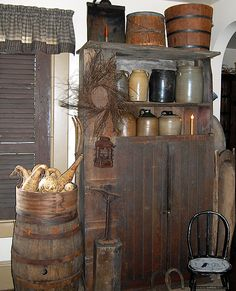 Primitive Cupboard With Crocks, Shoe Last, Chair, Wooden Buckets, Lantern, Dough Bowl