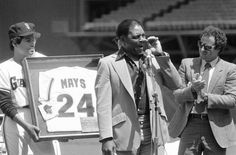 Baseball great Willie Mays, wipes away a tear as the San Francisco Giants…