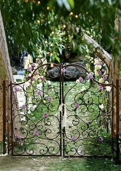 Magical garden entrance - my daughter's headboard looks just like this. she hates it. I should turn it into a gate! -- find a headboard, make a gate!