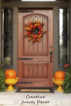She made her Tuscan front door herself - plus great spray paint ideas for fall pumpkin porch decorations - check it out.
