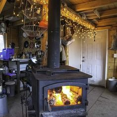 In my home the wood stove not a television is the centerpiece of the household. Not only does it provide all of the heat for the cabin it's also the only stove that we cook on and we use it to melt snow for drinking water baths or cooking. One must always use caution when operating a wood stove. Cabins burn down all the time and the most common cause is a chimney fire. You must always know what temperature your stove is at. If it burns too cool or too hot you can start a fire. You have to…
