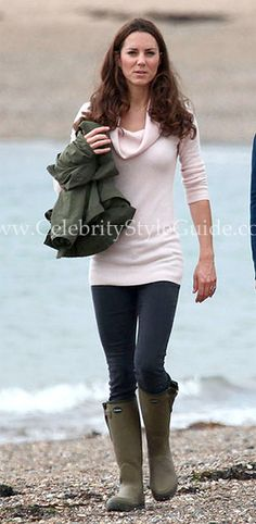Duchess Kate Middleton and sister Pippa take a casual, quiet walk along the waterfront at Llanddwyn Island near Wales on Saturday.
