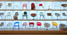 Lining up chairs in vertical cublicles and using background and overhead lighting to silhouette