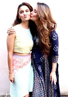 Isn't this the cutest picture? Kareena Kapoor plants a friendly kiss on Alia Bhatt's cheek at Mehboob Studio. #Bollywood #Fashion #Style #Beauty #Hot #Cute
