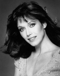 Tanya Roberts is angel Julie Rogers.