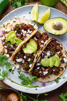Warmed tortillas filled tender carne guisada, tangy onions, cheese, cilantro and a splash of lime juice! Raw Food Recipes, Meat Recipes, Mexican Food Recipes, Cooking Recipes, Ethnic Recipes, Mexican Desserts, Freezer Recipes, Freezer Cooking, Drink Recipes