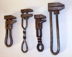 Flickr user whiteforge has a great collection of forged and antique tools. This is a set of adjustable wrenches.