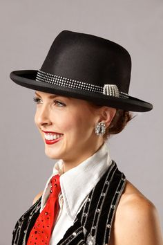 """The Rockettes """"City Rhythm"""" costume was designed by Deborah Newhall and introduced in 1999. #rockettes #NYC #costumes #dancers #glamorous #tophat #redtie #stripes #cuffs #vest #sparkle"""