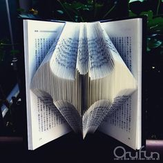 Intricately Folded Pages Transform Hardcover Books into Standing Sculptures by Japanese artist Yuto Yamaguchi