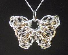 This original pattern derives from the pattern for the Celtic Star. Fittingly, feileacan is the Irish word for butterfly. Wear this beautiful, universal symbol of transformation wherever you go. Wire Wrapped Jewelry, Metal Jewelry, Beaded Jewelry, Pendant Jewelry, Gold Jewellery, Jewelry Shop, Jewlery, Pendant Necklace, Diy Schmuck