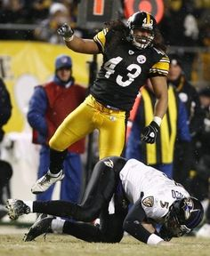 Steelers Troy Polamalu celebrates a sack on Baltimore Ravens! Steelers Football, Pittsburgh Steelers, Troy Polamalu, Steeler Nation, Baltimore Ravens, American Football, Champs, Motorcycle Jacket, Sports
