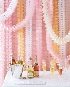 7 Creative Engagement Party Ideas | Martha Stewart Weddings - Upgrade the classic party decoration with cool, intricately designed ones. Hang them behind a bar, cake table, or any bare areas that need a little love. Find similar ones at Bulk Party Supplies.