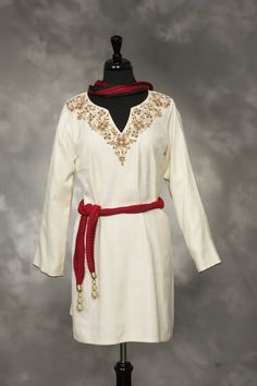 Ivory, embossed linen with brown and red embroidery and stones.