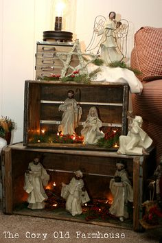 """The Cozy Old """"Farmhouse"""": I love the nativity set up in the crates like this!!"""