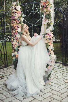 Hanging flower decorations are simply gorgeous but if you want to take it a step further, a floral-covered swing is the way to go. This idea is so creative for an outdoor reception and makes a stylish addition to your wedding photos. Wedding Swing, Woodsy Wedding, Quirky Wedding, Forest Wedding, Dream Wedding, Wedding Photography Styles, Wedding Styles, Wedding Photos, Terrarium Wedding Favor