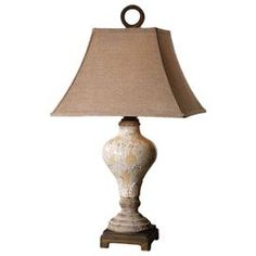 """Ceramic table lamp with linen shade.Product: Table lampConstruction Material: Polyester and ceramic Color: Distressed crackled ivory Features: Square rusty linen fabric bell shadeDesigned by Carolyn KinderAccommodates: (1) 150 Watt bulb medium base bulb - not includedDimensions: 29"""" H x 16"""" W x 16"""" D    Cleaning and Care: Wipe with soft dry cloth"""
