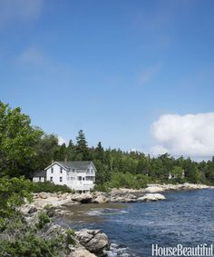 The shingled cottage on Southport Island, Maine, was built more than a century ago and is as close to the water as you can get on this rocky coastline.   - HouseBeautiful.com