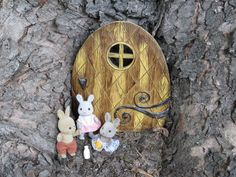 My Calico Critter family found the elf door in my ancient maple. Just their size.