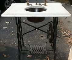 Gorgeous way to repurpose an old pedal-operated sewing machine frame!