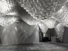 Undulating Ceiling Installations - Paper Chandeliers by Cristina Parreno Architecture