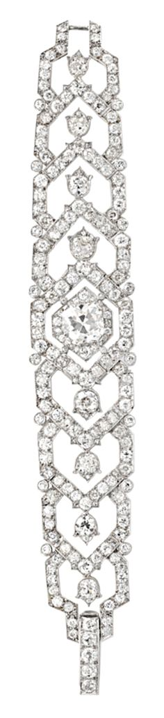 1940's diamond bracelet by Cartier. It centers a cushion-cut diamond, with two concentric old mine and old European-cut diamond hexagonal-shaped surrounds. On either side of the center diamond, the bracelet continues with four graduated, overlapping open hexagonal old European-cut diamond links, each segment set with an old European-cut diamond 'Lily of the Valley' motif. These are enclosed by a border spaced by collet-set diamonds, all set in platinum. Via Diamonds in the Library.