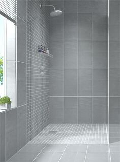 Create a modern looking bathroom by mixing different shapes of floor tiles…