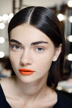 The Best Backstage Beauty Products - NYFW Spring 2015. Hail orange lip makeup