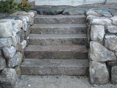 Granite stairs with fieldstone cheek walls.  Note that the granite tread is rough & slightly uneven, similar to your on-site material. Nadine likes