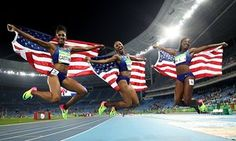 Athletics - Olympics: Day 12  RIO DE JANEIRO, BRAZIL - AUGUST 17: (L-R) Bronze medalist Kristi Castlin, gold medalist Brianna Rollins and silver medalist Nia Ali of the United States celebrate with American flags after the Women's 100m Hurdles Final on Day 12 of the Rio 2016 Olympic Games at the Olympic Stadium on August 17, 2016 in Rio de Janeiro, Brazil. (Photo by Cameron Spencer/Getty Images)