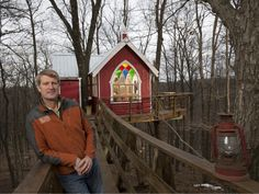 pete nelson owner of nelson treehouse and supply poses by a ohio brewery treehouse he designed on animal planets treehouse masters