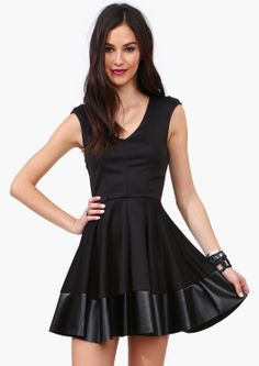 Dress with faux leather trim.