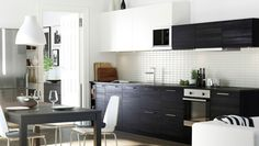 Kitchen with combination of white and black/brown TINGSRYD doors and drawer fronts