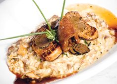 Crispy duck risotto with seared fois-gras and black truffles. Apicius Paris