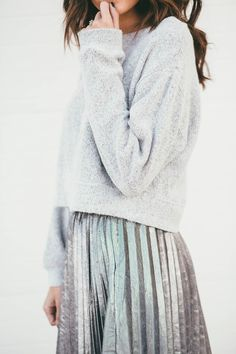 metallic pleated skirt and a fluffy jumper.