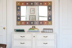 Alexandra's multicolored mirror is the focal point of this area. The space feels lively yet balanced with the off-white dresser. She found the mirror at Pier 1 Imports (no longer available).