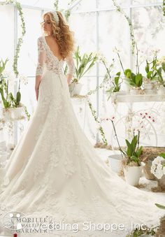 Mori Lee 2812: A beautiful lace wedding dress with 3/4 length sleeves and lace illusion back.