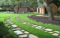 Pavers and Grass Ribbon Driveway, Gardenista. If the yard is leveled and replanted all at one time, would be an economical and beautiful solution for the driveway instead of concrete