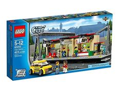 LEGO® CITY® Train Station Building with Taxi and Rail Track Pieces   60050. Includes 5 minifigures: conductor, chef, taxi driver and 2 travelers. Features a main entrance with stairs, opening glass doors, ATM, train map, LEGO® City shop with LEGO City products, desk and cash register, plus a food and drink kiosk with a cash register, coffee machine, 4 beverage bottles, 2 menu signs, croissant and a pizza. Train platform features a cross-track roof, clock, steps, 2 seats, bicycle, bicycle...