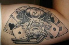 Tattoo.  Harley-Davidson engine, deuces, and snake-eyes.