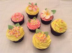 Plumeria cupcakes for a luau themed first birthday party