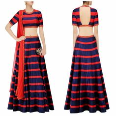 Featuring a red and navy blue flared lehenga skirt in art silk base with striped detailing all over highlighted with gold sequins floral embroidered bootis on the waistband. It is paired with matching navy blue and red striped art silk blouse with gold sequins embroidery on the neckline sleeves and hem. It comes along with red net dupatta with gold floral embroidered border. Code : S1041 Title : Navy Blue and Red Striped and Floral Sequinned Lehenga Set. Size : Free Color : Red & Navy Blue…
