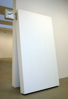 Michael Riedel  Double sided clock with contrary running directions and variable velocity on portable gallery wall, 2005