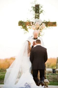 Large flower and vine covered wooden cross for behind alter; perfect for bringing in the chapel to an outdoor wedding