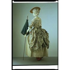 Polonaise Gown at the V&A, Accession T.30-1910.  This wonderful polonaise is pre-pleated so that is drapes beautifully when drawn up.
