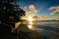 The End of the Day by Ronald T Brown, via Flickr.  Sunset from the lower beach at Mango Bay Resort. This has a little noise in the clouds but I love the way the light shines on the seawall.