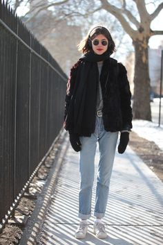 "15 Photos Of NYC Women Looking Winter Chic #refinery29  http://www.refinery29.com/nyc-winter-layering-street-style#slide-1  Name: Georgia GrahamSpotted At: McCarren ParkWhat She's Wearing: Vintage coat, vintage Levi's jeans, Adidas sneakers, Nike socks, and Ray-Ban glasses.What's the one winter accessory you can't live without? ""A fur coat!"""