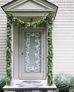 I love the garland around the door and the vinyl silhouette door decoration is cool, too. http://www.marthastewart.com/265872/winter-welcome-silhouette-door-decoratio?search_key=winter%20welcome