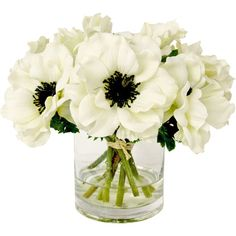 Craft a lush vignette that lasts through the seasons with this lovely faux floral arrangement, featuring white anemones nestled in a glass vase....