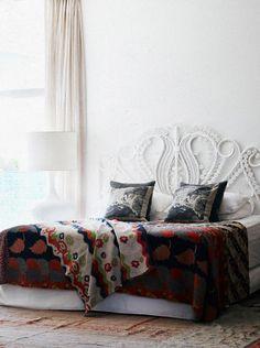 bed head-love the peacock headboard & white wall combo